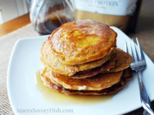 pumpkin flax pancakes with syrup on a plate
