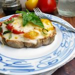 caprese eggplant pizza on a plate with a fork