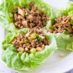 three chicken lettuce wraps on a plate