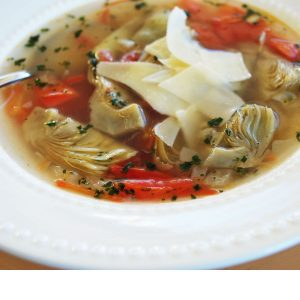 bowl of artichoke soup with Parmesan cheese on top