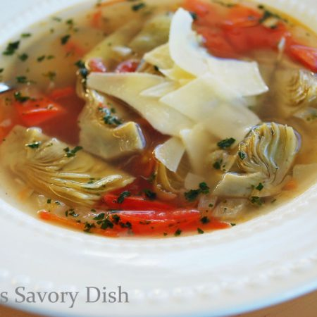 Artichoke soup, sometimes called Zuppa Di Carciofi, is a flavorful, broth based Italian soup, made with artichokes, roma tomatoes, onions, and fresh herbs.