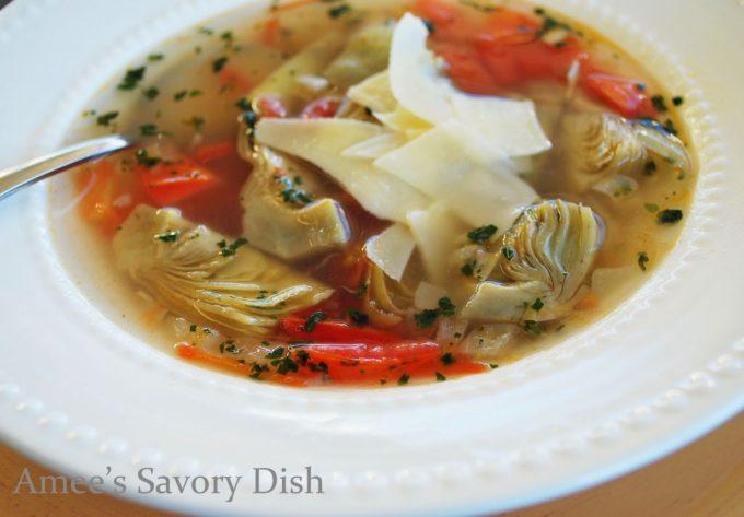 Artichoke soup in a white bowl