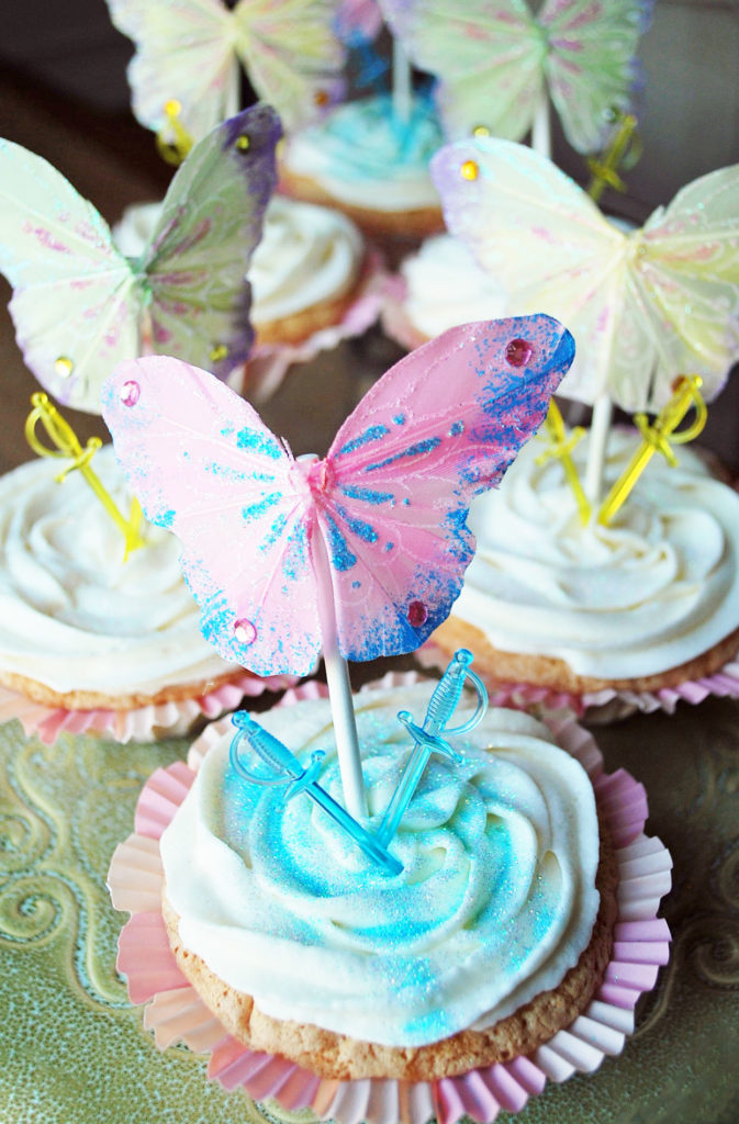 Pirate Fairy movie themed cupcakes with butterflies and plastic swords