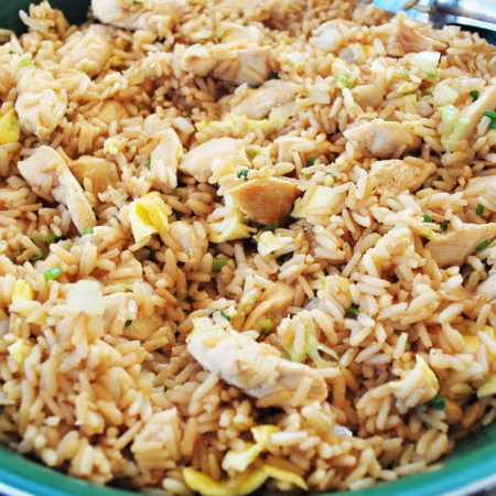 chicken fried rice in a green bowl