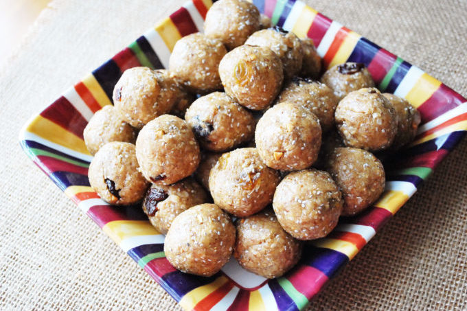 A quick and easy recipe for energy bites made with peanut butter, dried fruit and seeds for a nutrient dense snack on-the-go.