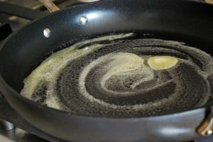 melted butter in pan for quiche filling