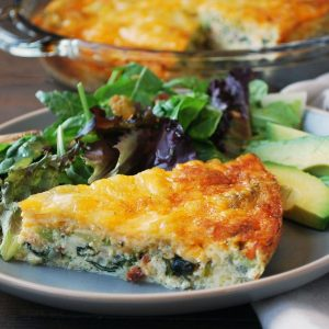 plate of quiche with salad and avocado