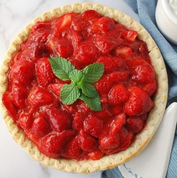 strawberry pie with a sprig of mint on top