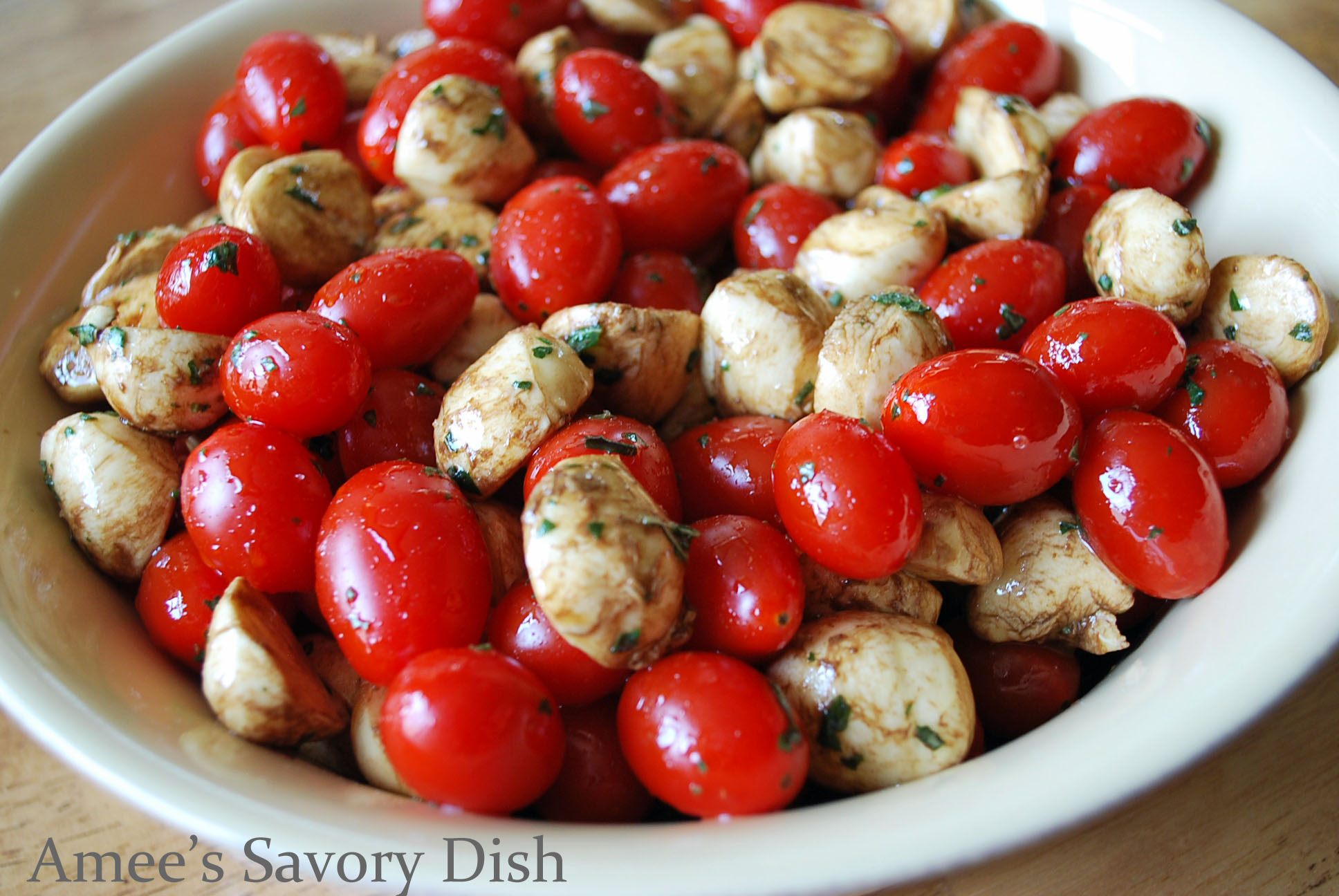 Caprese salad is a healthy summer salad, with fresh garden tomatoes, fresh basil, and fresh mozzarella cheese.