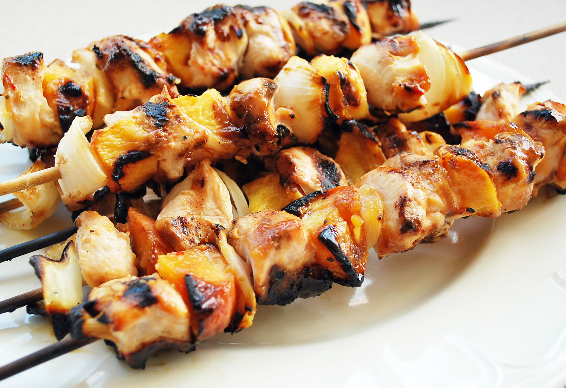 Georgia peach chicken kabobs use in-season fresh, local peaches and fresh Vidalia onions. This delicious and easy chicken kabobs recipe is a family favorite