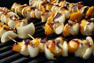 peach chicken kabobs on the grill cooking