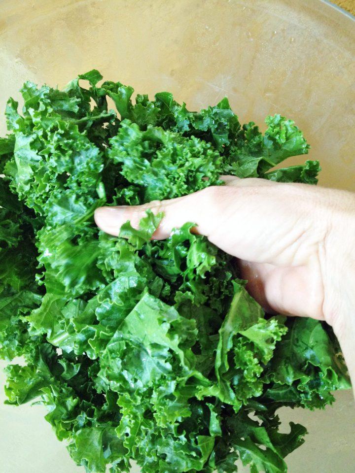 massaging kale leaves