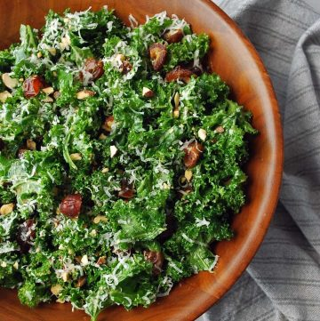 close up of a large serving bowl of kale crunch salad with dates and Parmesan