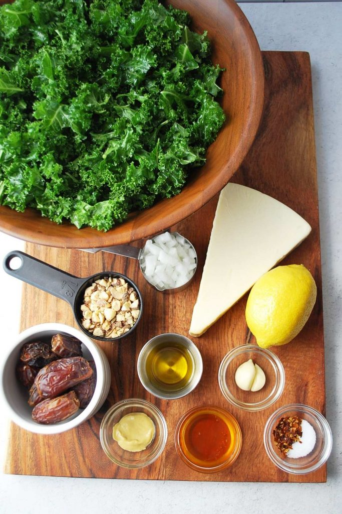 ingredients for kale crunch salad on a wood cutting board