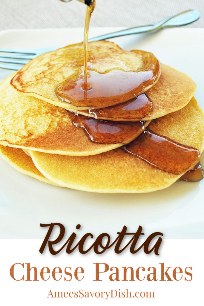 stack of ricotta cheese pancakes on a plate with fork and syrup