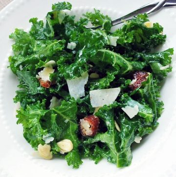 overhead shot of bowl of kale salad with dates and parmesan cheese