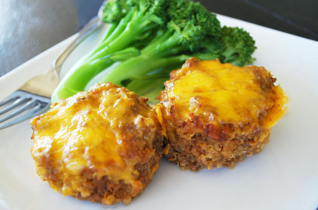 two barbecue meatloaves topped with cheese on a plate with broccoli