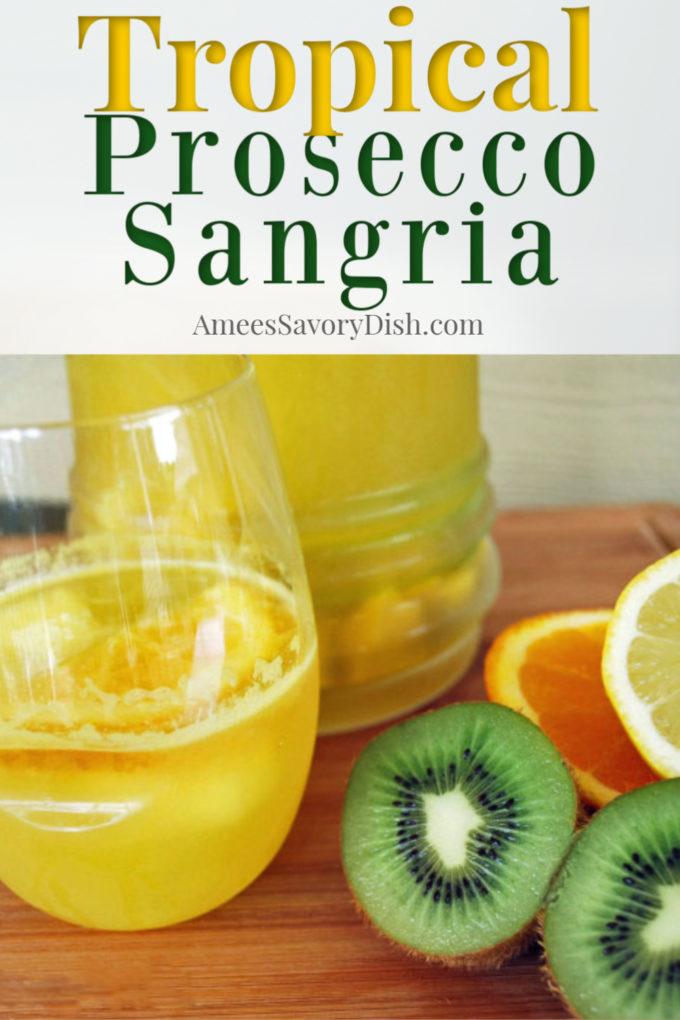 glass and pitcher of tropical sangria made with kiwi, orange and lemon