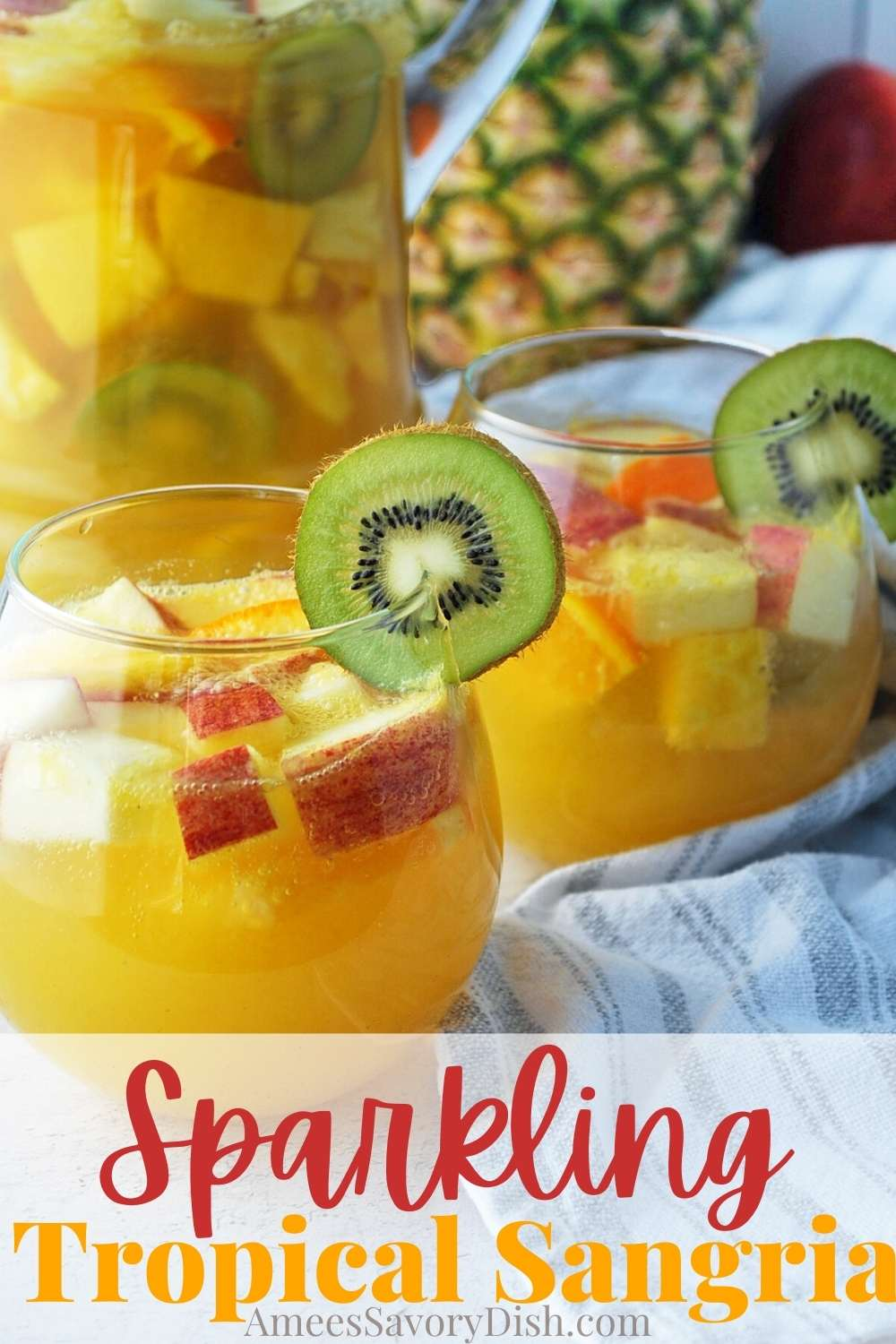 Sparkling tropical sangria is the perfect summer cocktail. Kiwi fruit, oranges, and bubbly prosecco make for a light, refreshing summer sangria recipe. via @Ameessavorydish