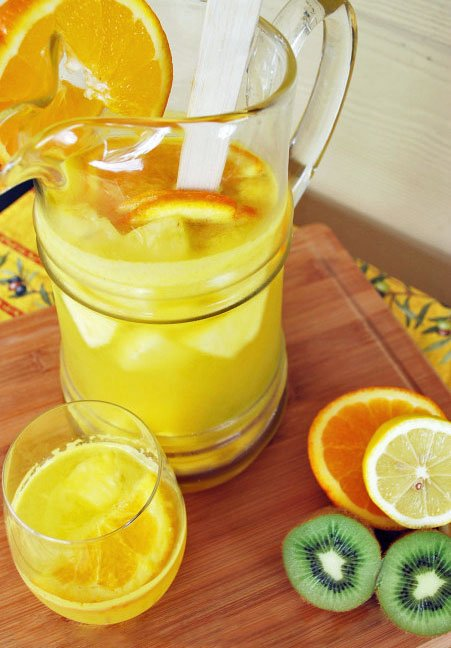 Pitcher of Prosecco sangria made with Prosecco sparkling wine, oranges, kiwi fruit and lemons.