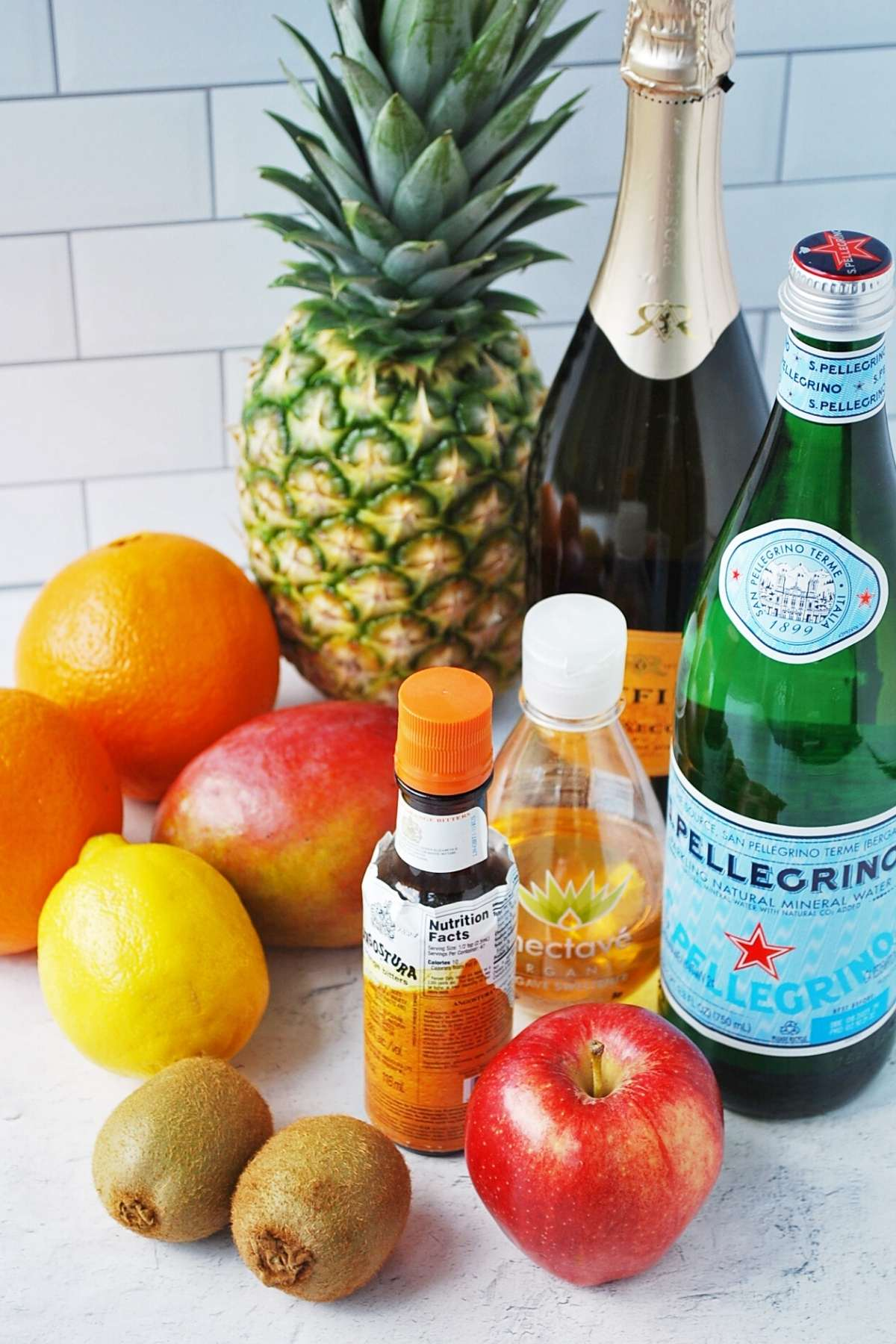 tropical sangria ingredients on a cutting board
