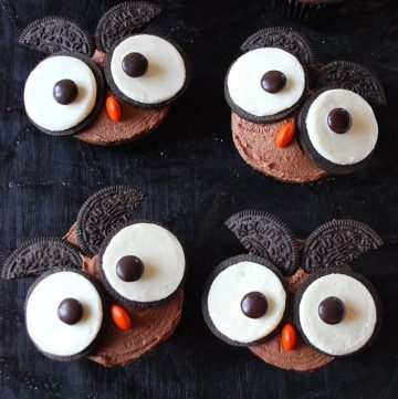 chocolate cupcakes with owl faces made with oreo cookies and M&M's candies