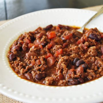 bowl of beef chili with a spoon