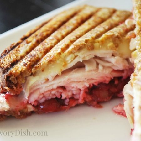 A close up of a Brie panini sandwich on a plate