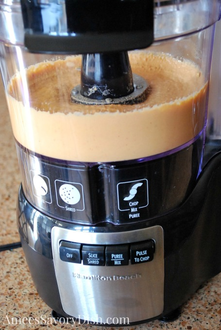 making homemade roasted red pepper hummus in a food processor
