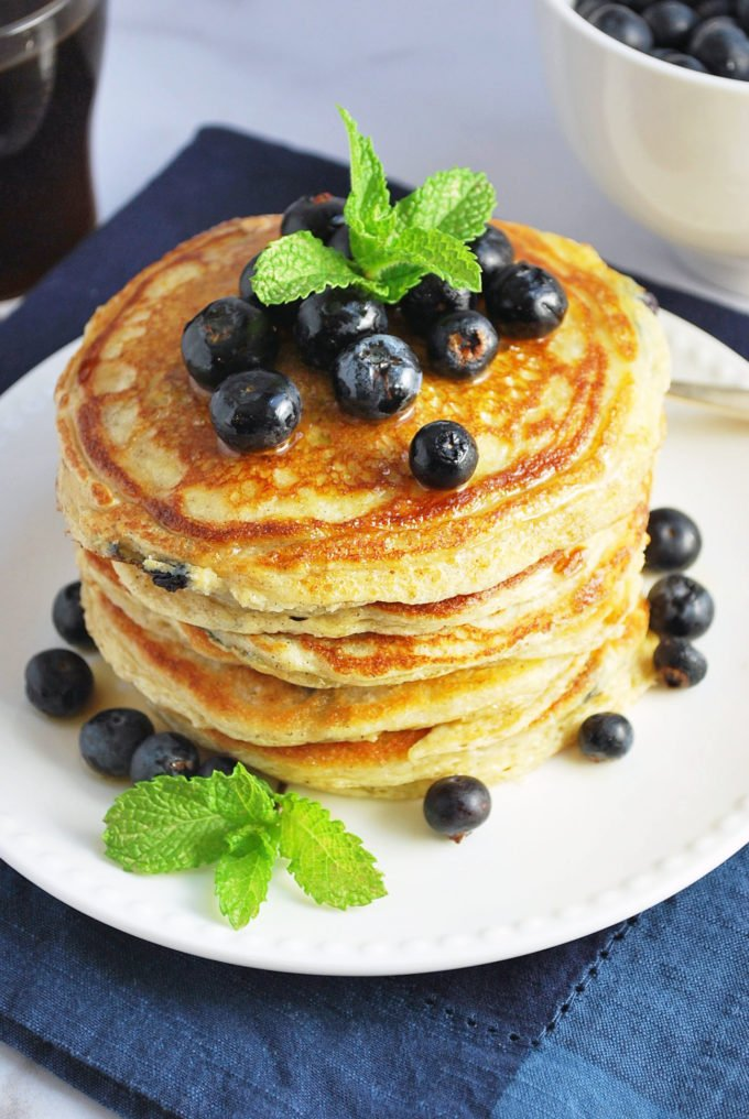 Wild blueberry protein pancakes make for a delicious, healthy breakfast. Protein-packed, buttermilk oat pancakes, bursting with wild blueberries. An easy breakfast recipe, too! #proteinpancakes #blueberrypancakes #wildblueberries #pancakerecipe via @Ameessavorydish