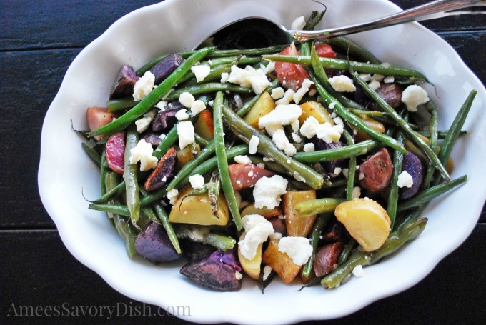 Roasted fingerling potato salad with green beans and feta cheese is a delicious and easy to make side salad recipe. Perfect for picnics or potlucks, it comes together in a snap!