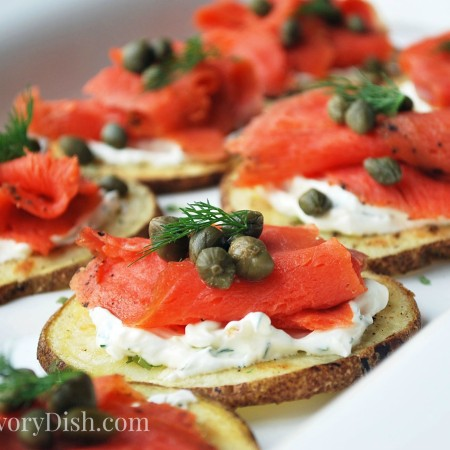 Smoked salmon potato rounds with creamy yogurt, chives, and capers are a healthy game day appetizer or an elegant party snack.