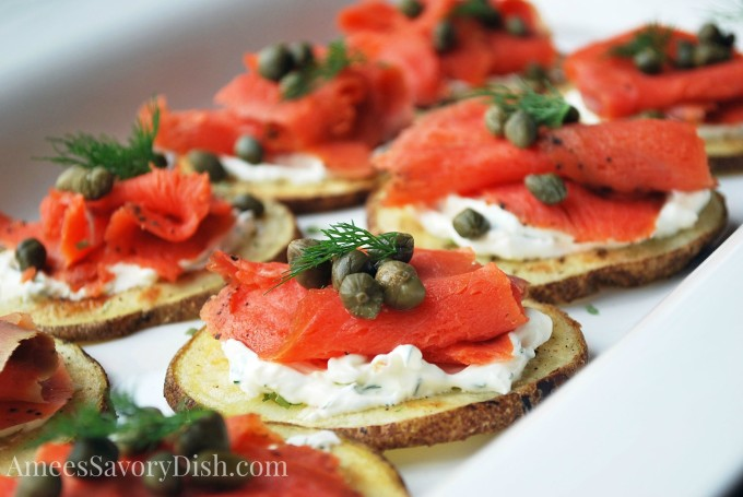 Smoked Salmon Potato Rounds with creamy yogurt, capers, and chives.