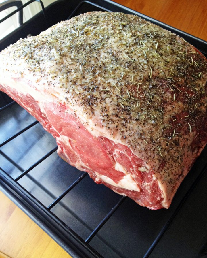 standing rib roast on a rack ready to cook