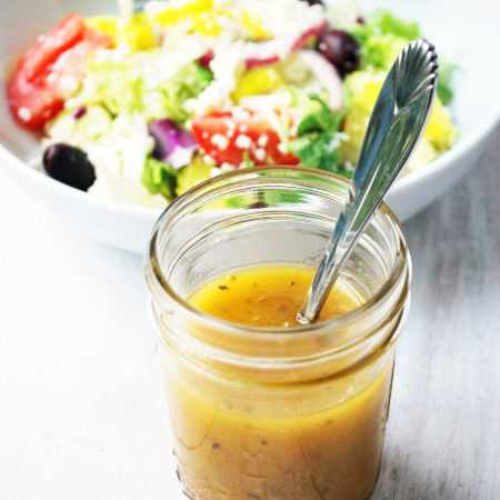 Homemade Greek Dressing recipe in a jar
