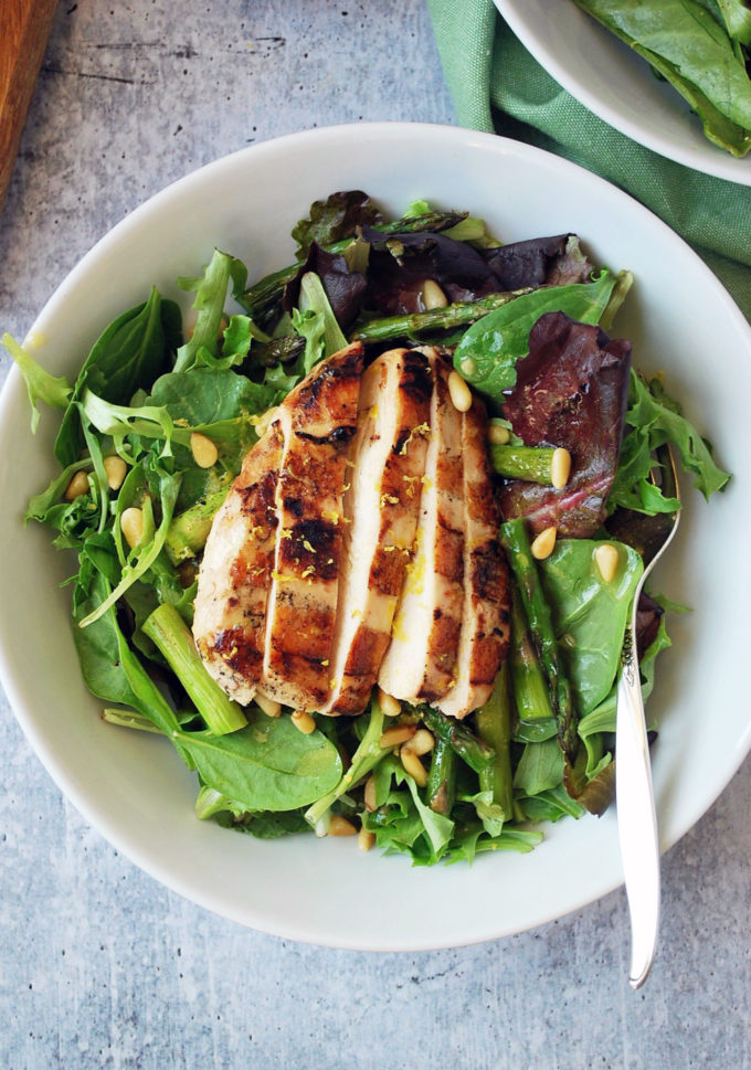 Grilled chicken salad with asparagus and lemon balsamic vinaigrette in a bowl