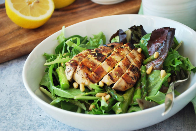 The best grilled chicken salad with fresh asparagus in a bowl
