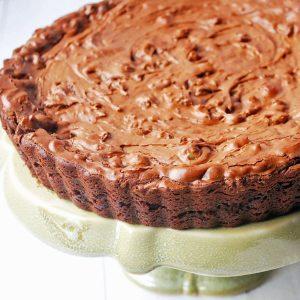 brownie tart on a green platter