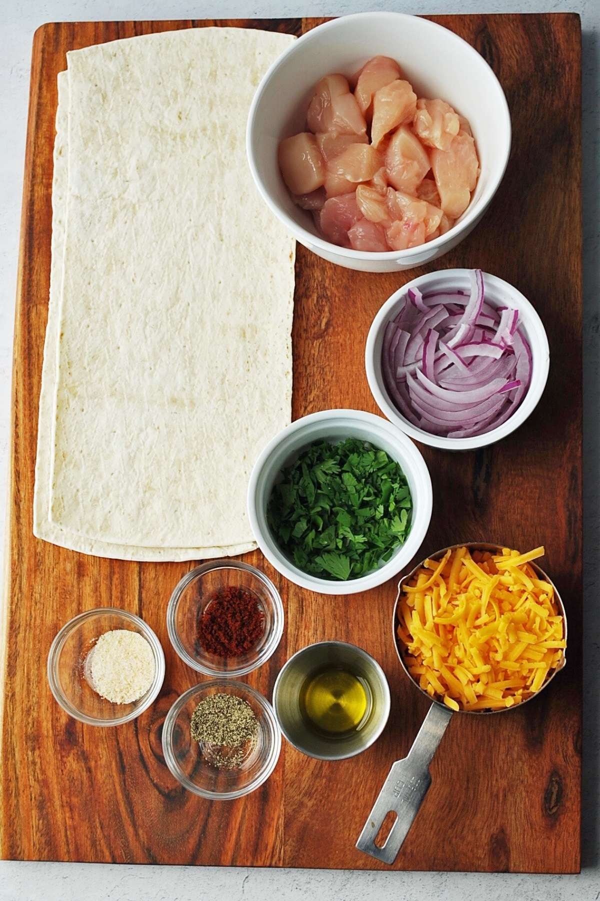 ingredients for BBQ chicken flatbread on a cutting board