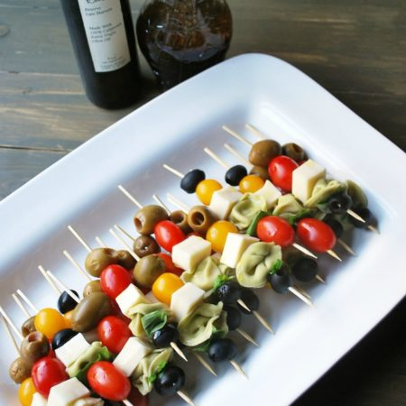 Caprese skewers on a white platter