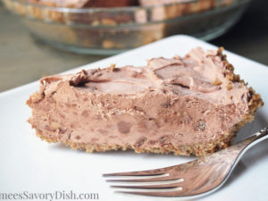 A tasty recipe for whipped chocolate icebox pie with pecan pie crust made with no flour or added sugar and chilled for a perfect summertime dessert.