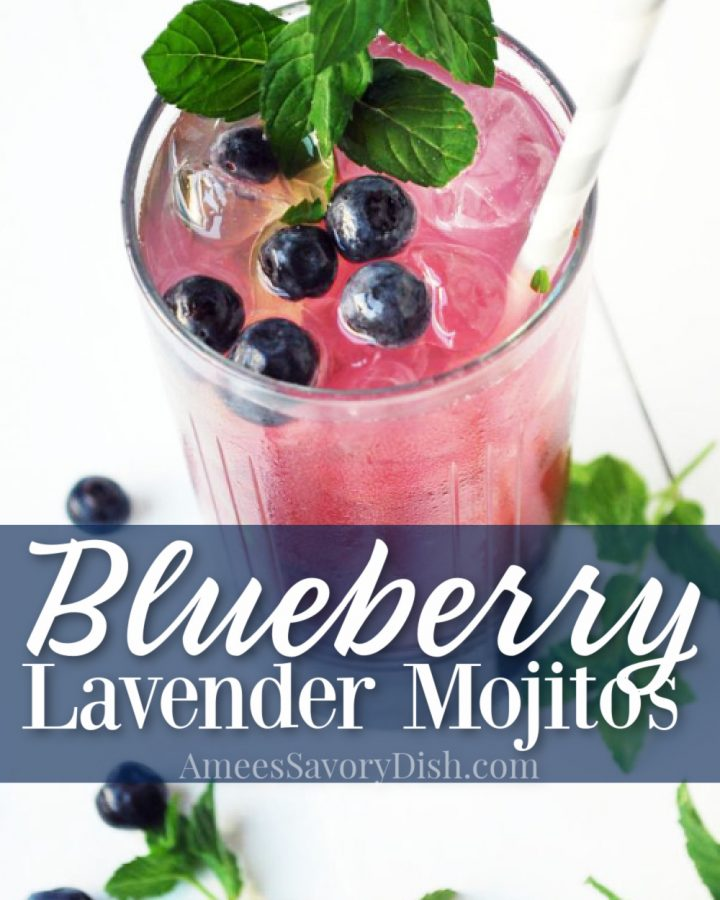 blueberry lavender mojito in a glass with berries and mint
