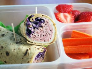 A simple and easy light Reuben wrap sandwich recipe made with sliced deli roast beef, baby swiss cheese, red cabbage, homemade thousand island dressing rolled up in a high fiber wrap.