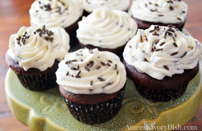 A simple recipe from scratch for super Moist Devil's Food Cupcakes with a rich and delicious buttercream chocolate chip frosting.