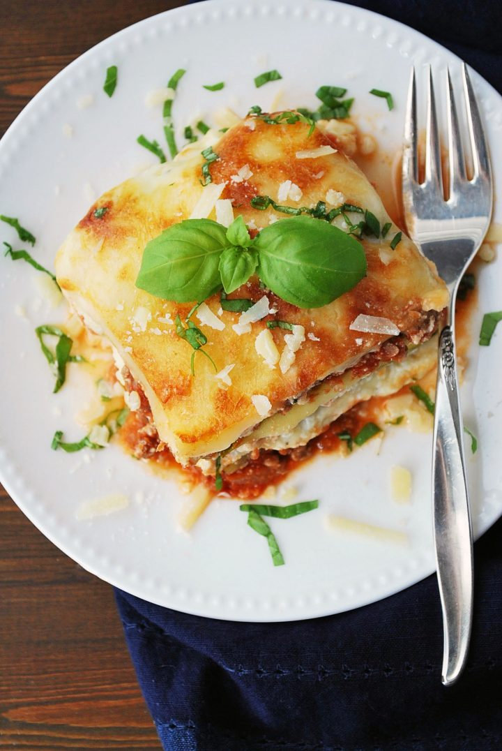 overhead shot of zucchini lasagna on a plate with basil on top