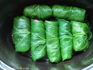 steak stuffed collard green rolls in the slowcooker