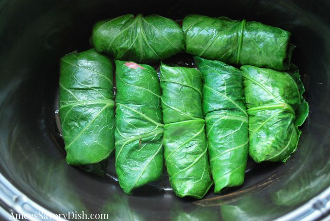 Steak stuffed collard green rolls in the slow cooker