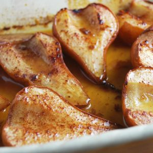 roasted pear halves in a baking dish