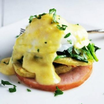 gluten free eggs benedict with spinach on a plate