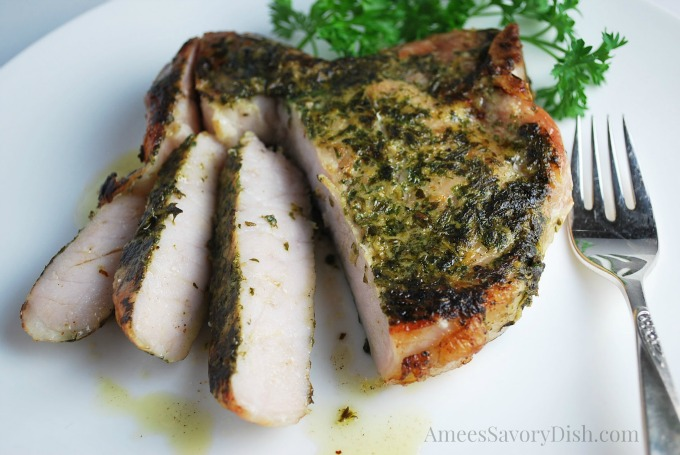 Sliced Sous Vide pork chop with fresh herbs
